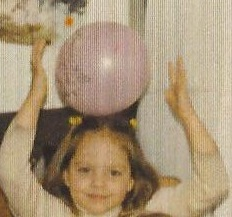 Eleanor with balloon on her head